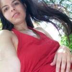 Zuzinka loves wearing short red dresses